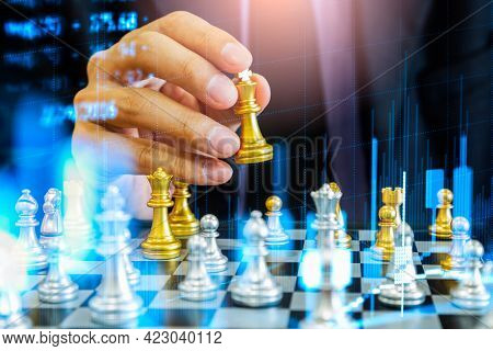 Chess Game On Chess Board Behind Business Man Background. Business Concept To Present Financial Info