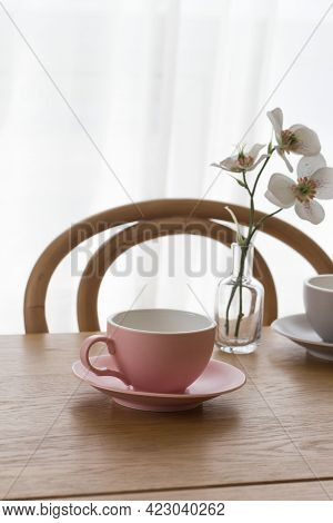 Pink Empty Coffee Cup On Wooden Table.