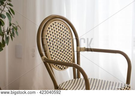Wooden Chair In Front Of The Curtain