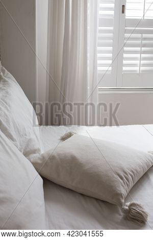 White Themed Bed Sheets And White Curtain, Bedroom Interior.