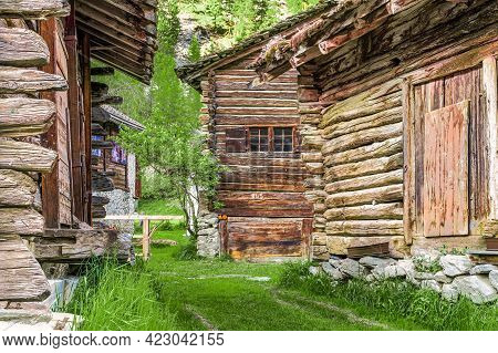 Traditional Wooden Cottages In Evolene, A Village In The Valley Of Herens In The French-speaking Par