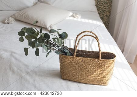 Rattan Bag With Plant On The White Bed