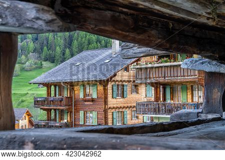 Traditional Wooden Houses In Evolene, A Village In The Valley Of Herens In The French-speaking Part