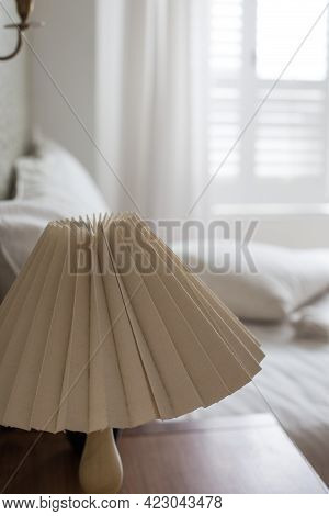 Bedhead With Table Lamp On Side Table. Bedroom Interior Decorated With Cozy Design