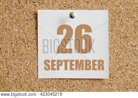September 26. 26th Day Of The Month, Calendar Date.white Calendar Sheet Attached To Brown Cork Board
