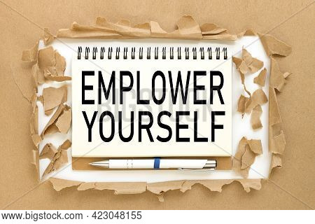 Empower Yourself. Text On Notepad Near Torn Paper
