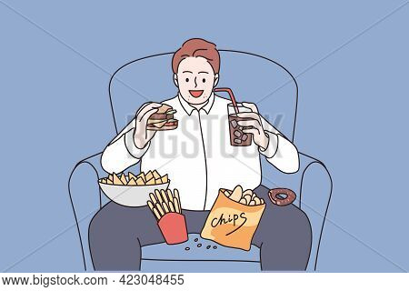 Over Weight And Unhealthy Eating Concept. Young Smiling Man Cartoon Character Sitting In Armchair Ea