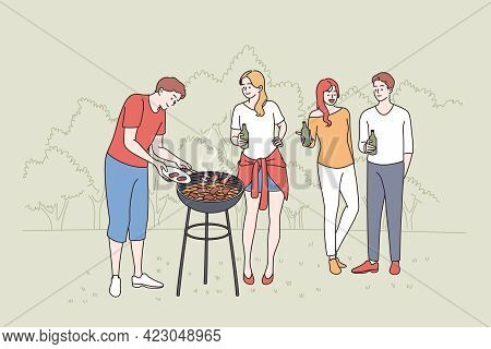 Having Picnic And Barbecue Concept. Group Of Young Happy Smiling Friends People Standing Chatting Ha