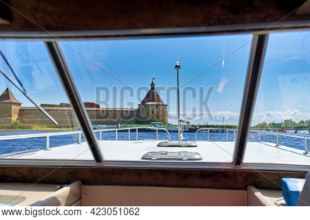 View From The Cabin Of A Tourist Boat To The Old Fortress. Fortress Oreshek On A Sunny Spring Day