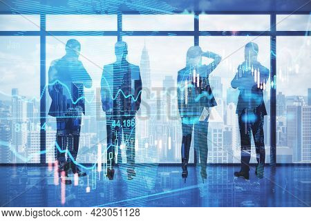 Pensive Backlit Businesspeople Standing In Blurry Office With Forex Chart And City View. Meeting And