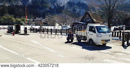 Japan - February 23, 2019: The Man, Engineer Or Maintenance Guy Fixing Repair Damage Street Or Road