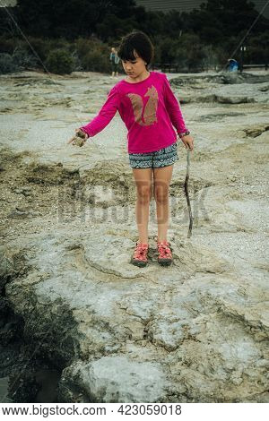 portrait of young child kid girl on hot springs background
