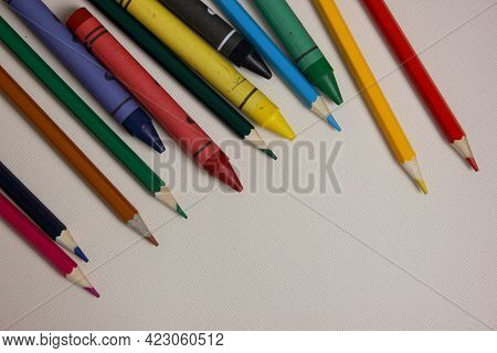 Colored Pencils On White Background. Lots Of Different Colored Wax Pencils. Colored Pencil. Pencils