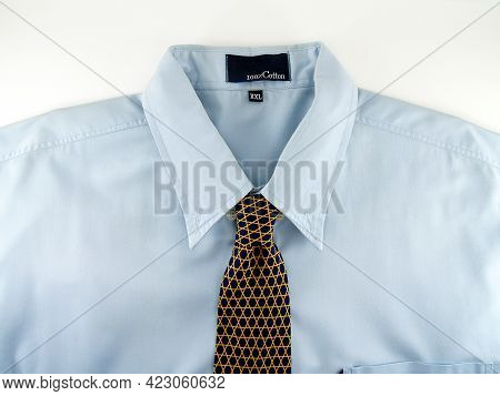 Close Up Part Of Blue Business Shirt With Size And Type Label On Inside Collar And Black Necktie Wit