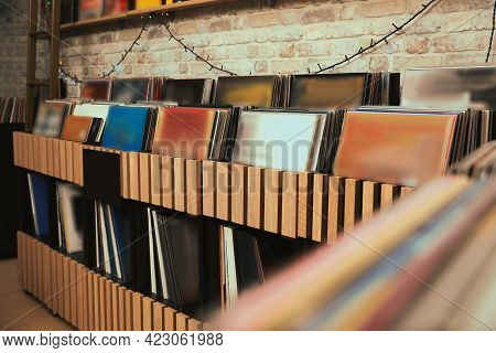 Rack With Different Vinyl Records In Store