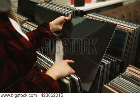 Woman Choosing Vinyl Records In Store, Closeup