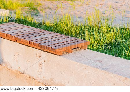 New Concrete Bench With The Small Timber In The City's Park. Outdoor. Nature. Comfort. Landscape Des