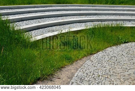Tribune In The Park By A Concrete Staircase Made Of Gray Granite Stones Into An Arch In The Middle O