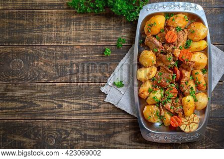 Roast Pieces Of Turkey With Vegetables Serving On The Metal Tray On Wooden Background. Top View, Fla