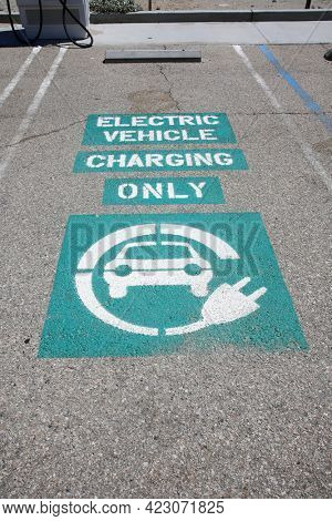 Palm Springs California - June 6, 2021: electric car charging station. EVgo is a Self Contained Electric Vehicle Charging Station. Electric Cars are becoming more and more popular. Editorial Use Only