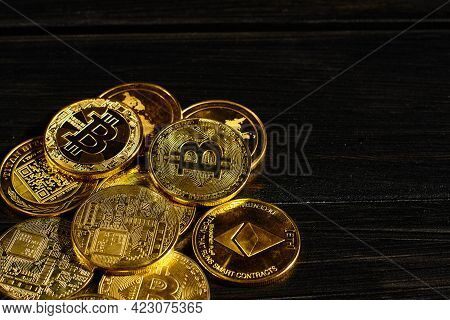 Closeup Golden Coin With Bitcoin Logo. Leader In Cryptocurrency Bitcoin Btc On A Top Of Coins Agains