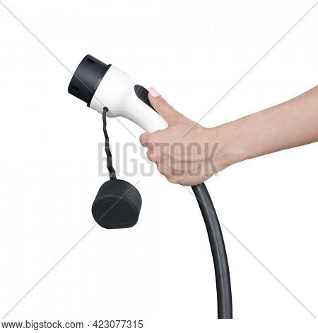 Hand is holding fast electric car charger green energy environment friendly driving vehicle station. Modern transport fuel of future. Minimal design power unit