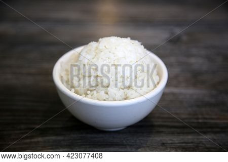White steamed rice in a dish. Chinese Steamed Wite Rice in a white bowl. Chinese Lunch. White Rice. Chinese food.
