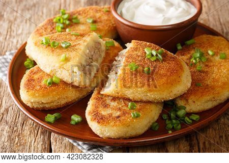Traditional Ukrainian Cuisine Tasty Potato Zrazy With Meat Close-up In A Plate On The Table. Horizon