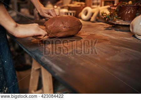 Unrecognized Woman At The Delicate Modeling Process With Earthenware Tool In Pottery Workshop