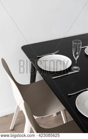 Vertical Shot Of Black Matt Kitchen Table With Dinner Set Up, View From Above. White Dinnerware, Win