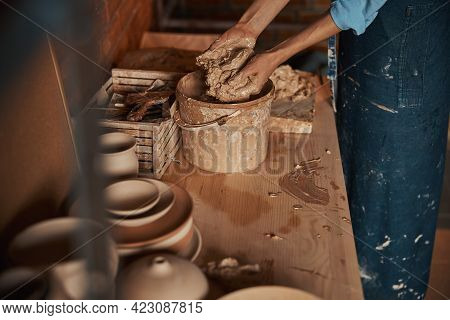 Charming Young Craft Woman Wearing Apron Preparing Earthenware Materials For Modeling Ceramic Produc
