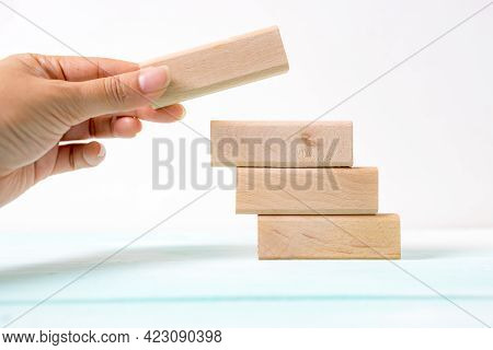 Hand Arranging Wood Block Stacking As Step Stair. Business Concept For Growth Success Process. Stair