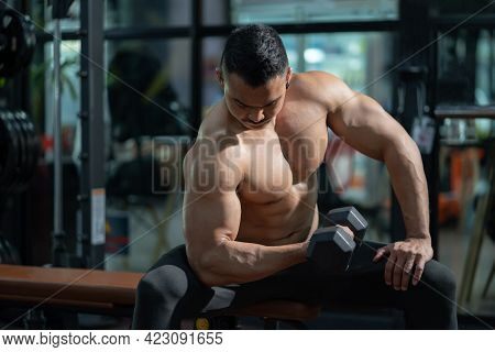 Handsome Shirtless Adult Asian Men Sweating While Lift Up The Dumbbell Workout For Arm Biceps Muscle