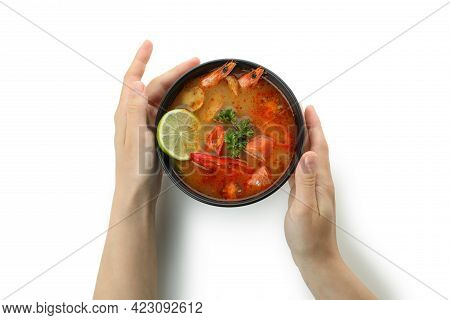 Female Hands Hold Tom Yum Soup, Isolated On White Background