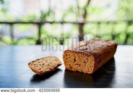 Fresh Home-baked Rye Bread Lie On A Wooden Table