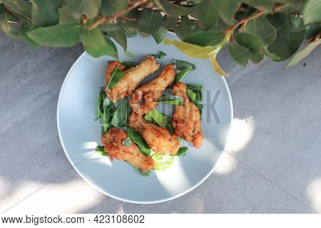 Fried Chicken ,deep Fried Chicken Or Grilled Chicken And Fried Kaffir Lime Leaves