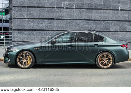 Moscow, Russia - June 2021: Luxury Supercar Bmw M5 Cs Frozen Deep Green Metallic Color Parked Next T
