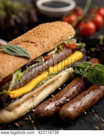 Appetizing Hot Dog. Bread With Sausages, Cheese And Salad. Hearty Burger With Sesame Seeds, Nutritio