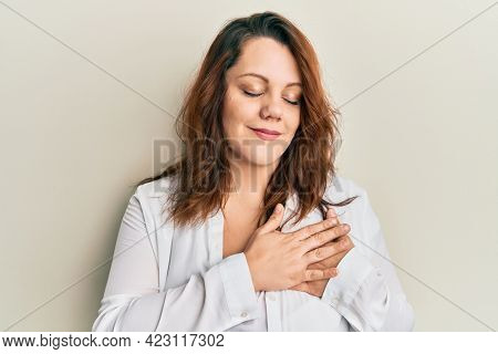Young caucasian woman wearing casual clothes smiling with hands on chest, eyes closed with grateful gesture on face. health concept.