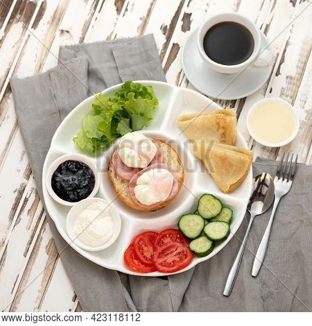 Traditional European Or American Continental Breakfast On Rustic Wooden Table With Linen Tablecloth.