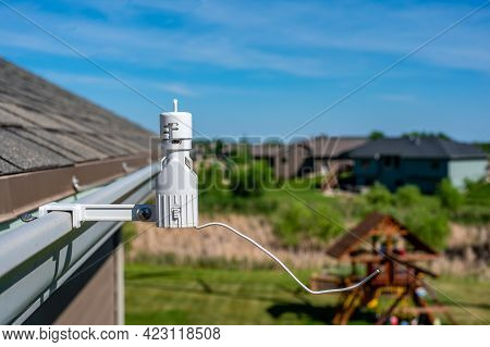 Wireless Sprinkler Rain Sensor Used To Conserve Water. Device Is Installed On A Residential Roof Gut