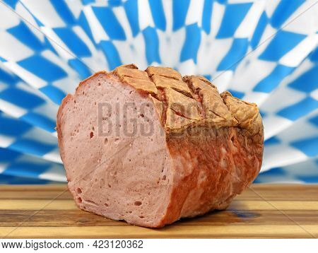 Warm Bavarian Meat Loaf Or Leberkaese On A Wooden Plate Served In Front Of A Typical Bavarian Diaman