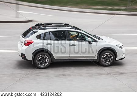 Moscow , Russia - May 2021: Subaru Xv Vehicle On The City Road. Fast Moving White Car On Moscow Stre