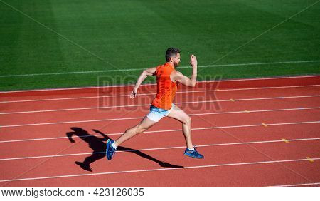 Energetic Athletic Muscular Man Runner Running On Racetrack At Outdoor Stadium, Competition