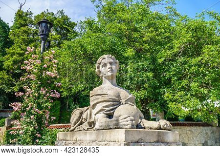 Statue Of Mythical Sphinx With Female Head In Park Of Massandra Palace. Shot Near Yalta, Crimea