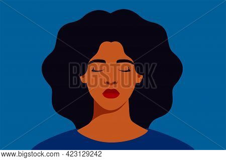 Sad Black Woman With Closed Eyes On A Blue Background. Portrait Of Weeping Girl Emotions Grief. Unha