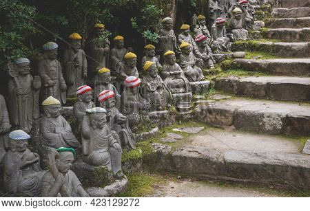 Buddha Statues With Knitted Colorful Hat Offerings Along Stairs Representing The First 500 Disciples