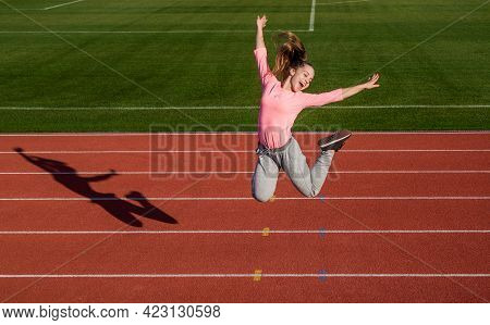 Being Energetic Is The New You. Energetic Child Jump On Athletics Track. Active Lifestyle