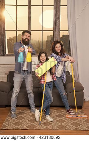 No Chances For Dust Allergy. Mother Father And Child Cleaning Home With Mops