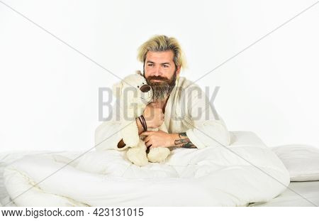Mature Man With Toys In Bed. Feel Childish. Bearded Man Hipster Play With Bear. Toys For Adult. Feel